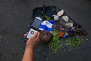 5 July 2009 - Tegucigalpa, Honduras - A upporters of ousted Honduras' President Manuel Zelaya takes a photo of a temporary memorial around the  blood and pieces of skull of a 21 year old man's killed by soilders while fleeing teargas at the airport in Tegucigalpa. President Zelaya was unable to land today, but pledged to return in the coming days. His supporters have been marching in the capital's streets since he was ousted last Sunday, but the protests have increased dramatically in the last few days.