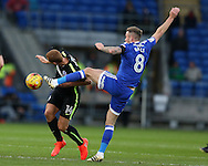 Steve Sidwell of Brighton (l) gets caught by a boot to his head by Joe Ralls of Cardiff city. EFL Skybet championship match, Cardiff city v Brighton & Hove Albion at the Cardiff city stadium in Cardiff, South Wales on Saturday 3rd December 2016.<br /> pic by Andrew Orchard, Andrew Orchard sports photography.