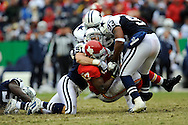 October 11, 2009:   Defenders Anthony Spencer #93 Keith Brooking #51 of the Dallas Cowboys tackle running back Larry Johnson #27 of the Kansas City Chiefs for a loss in the fourth quarter at Arrowhead Stadium in Kansas City, Missouri.  The Cowboys defeated the Chiefs in overtime 26-20...