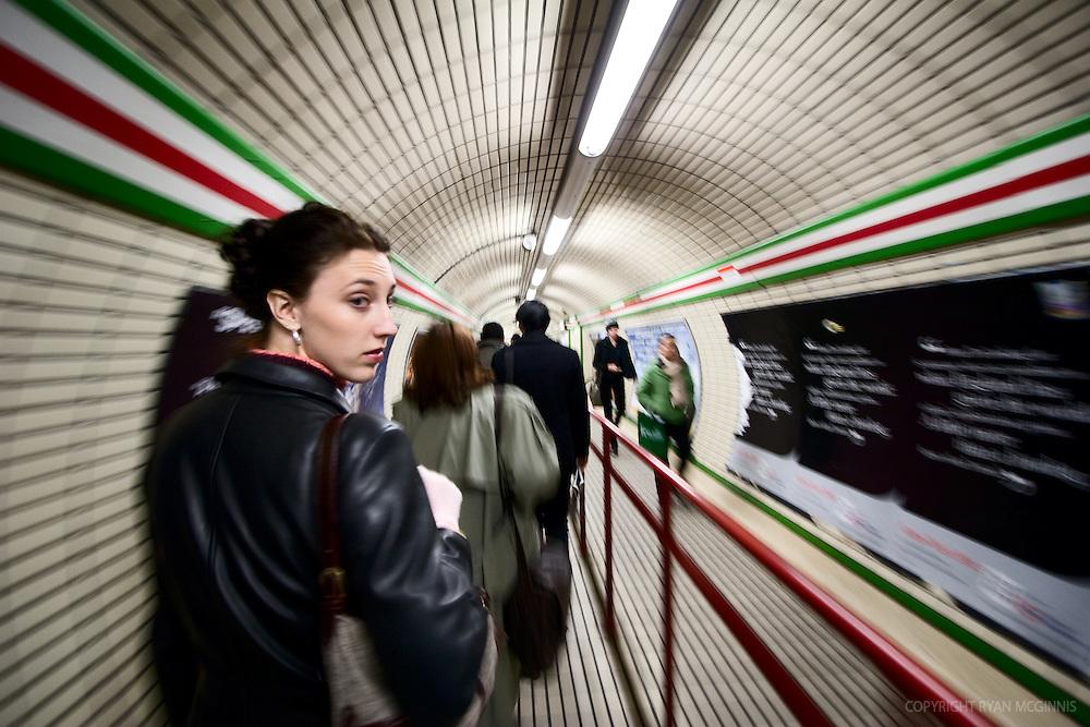 Woman walking in the tube, London, UK, December 6, 2007.