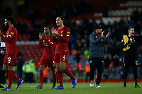 Football - 2019 / 2020 Premier League - Liverpool vs. Everton<br /> <br /> Virgil van Dijk of Liverpool applauds the Kop at the end of the game , at Anfield.<br /> <br /> COLORSPORT/ALAN MARTIN
