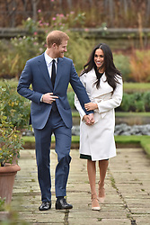 """File photo dated 27/11/17 of the Duke and Duchess of Sussex in the Sunken Garden at Kensington Palace, London, after the announcement of their engagement. The royal couple have announced they are to """"step back"""" as senior members of the royal family and will now divide their time between the UK and North America."""