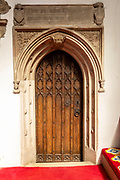 Interior of church of Saint Mary, Halesworth, Suffolk, England, UK - Vestry door dating from late 15th century