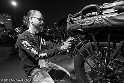 Chrystiano Miranda of Brazil does evening maintenance on Dean Bordigioni's 1923 Harley-Davidson JS in the hotel parking lot after stage 14 - (284 miles) of the Motorcycle Cannonball Cross-Country Endurance Run, which on this day ran from Meridian to Lewiston, Idaho, USA. Friday, September 19, 2014.  Photography ©2014 Michael Lichter.