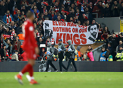 Liverpool fans in the stands holding a banner in support their players after the game
