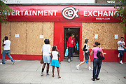 Closed up Entertainment Exchange shop on Camberwell Road in South London. This is a very common site all over London and the rest of the country due to the recent economic downturn, struggling economy. However in this case the shop has it's windows closed up due to the recent London riots. Specifically stores selling sports gear, electric goods, mobile phone and entartainment shops were targeted.