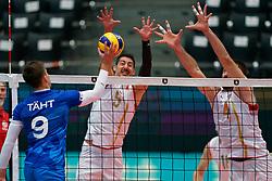 14-09-2019 NED: EC Volleyball 2019 Estonia - Montenegro, Rotterdam<br /> First round group D - Montenegro win 3-0 / Robert Täht #9 of Estonia, Rajko Strugar #5 of Montenegro, Gojko Cuk #4 of Montenegro