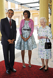 President of the United States Barack Obama (left) and first lady Michelle Obama (second left) pose with Queen Elizabeth II as they arrive at Buckingham Palace, in central London, on the first day of President Obama's three-day state visit to the UK.