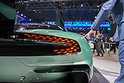 New York, NY - 1 April 2015. A man's hand reaches out to touch an ASton Martin Vulcan at the New York International Auto Show. The Vulcan is a track-only supercar with a V12 engine.