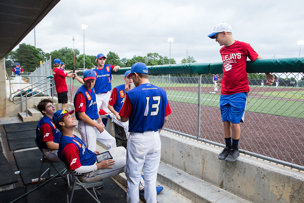 Grayson Gilbert, 11, stand in the dugout. Post 1 Omaha, Nebraska, played Post 307 Renner, South Dakota, in a legion baseball game at Creighton Prep on Wednesday, June 20, 2018, in Omaha, Nebraska.