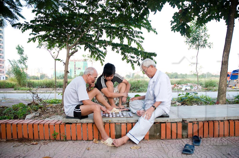 Men playing chinese chess in Me Tri Ha, Hanoi, Vietnam, Southeast Asia