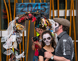 Pictured: Climate Change Protest. Scottish Parliament, Edinburgh, Scotland, United Kingdom, 20 June 2019. Climate change protestors outside the parliament, including Extinction Rebellion Scotland, protest in a mass theatrical dancing die-in along with jazz music. The protestors are campaigning for the Scottish Government to set a Net Zero Emissions by 2025 target when the Scottish Climate Bill is amended this month. The protestors set up a 'Holyrood Rebel Camp' outside the parliament for 5 days, culminating in today's event.<br /> <br /> Sally Anderson   EdinburghElitemedia.co.uk