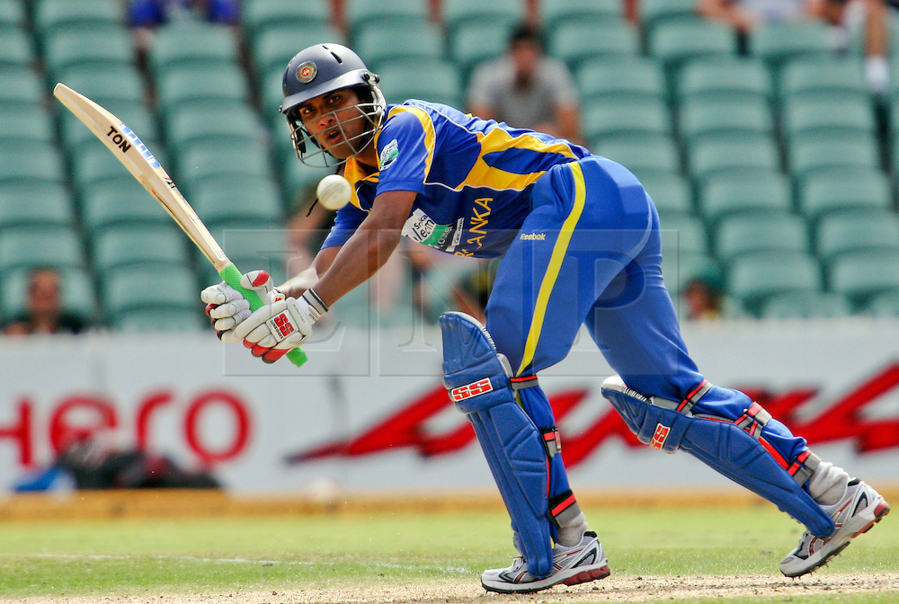© Licensed to London News Pictures. 14/02/2012. Adelaide Oval, Australia. Sri Lankan batsman Dinesh Chandimal plays a shot of his pads & keeps his eye on the ball as he is about to go for a run during the One Day International cricket match between India Vs Sri Lanka. Photo credit : Asanka Brendon Ratnayake/LNP