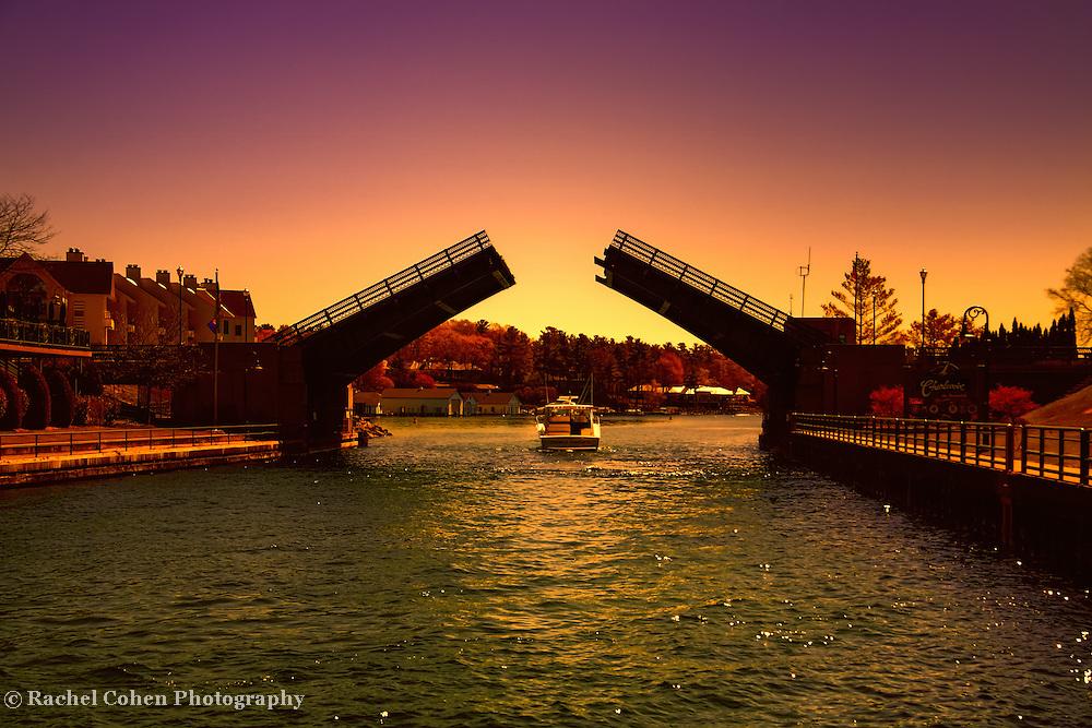 """Cruisin in Color""<br /> <br /> Beautiful sunset cruise through the drawbridge in Charlevoix Michigan!"