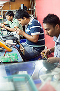 Computer repair workshops in the market in Nehru Place. Nehru Place is a commercial hub in South Delhi that is dominated by electrical and computer and technology shops and New Delhi, India