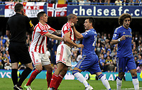 Football - Premier League <br />Chelsea vs Stoke City<br />John Terry grabs hold of Jonathan Walters who wants a word with David Luiz fight