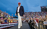 Aug. 21. 2015 Mobile, AL, Republican presidential candidate and business mogul Donald Trump enters his campaign pep rally in Ladd Peebles Stadium. Over 20 thousand came to the Ladd-Peebles Stadium to attend Trumps campaign pep rally. People were asked not to bring signs.