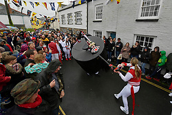© Licensed to London News Pictures. 01/05/2017 May Day celebrations in Padstow Cornwall. The Red Oss. The Blue Oss and the Red Osds lead the traditional May Day celebrations around the historic harbour of Padstow in Cornwall.<br /> Despite the rain large crowds attended the annual event.Photo credit : MARK HEMSWORTH/LNP
