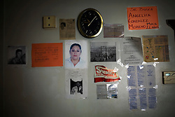 Posters of people who went missing trying to illegaly enter the US hang in an office that assists migrants.