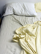 close up of uh unmade bed and rumpled sheets