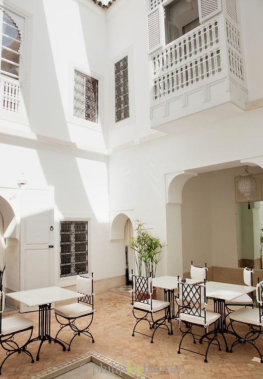 The courtyard of a riad, traditional Moroccan house, that has been converted into a luxury hotel in Marrakech, Morocco
