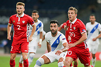 ATHENS, GREECE - OCTOBER 11: Giorgos Tzavellasof Greece and Sergiu Platicaof Moldova during the UEFA Nations League group stage match between Greece and Moldova at OACA Spyros Louis on October 11, 2020 in Athens, Greece. (Photo by MB Media)