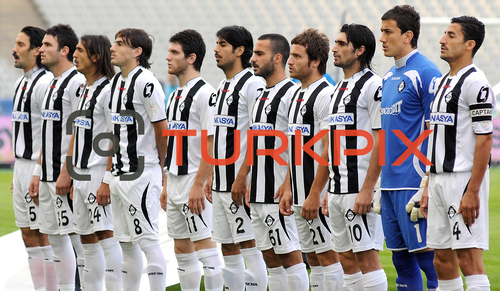 Altayspor's players (Left to Right) Yigitcan ERDOGAN, Musa CAGIRAN, Burak CALIK, Jorge Emanuel MOLINA, Musa Sinan YILMAZER, Ercan UNAL, Yuksel KAYAALP, Mesut CAYTEMEL, Sehmus OZER, goalkeeper Soner SAHIN, Mehmet BUDAK during their Turkish soccer Play Off final match Altayspor between Konyaspor at Ataturk Olympic Stadium in Istanbul Turkey on Sunday, 23 May 2010. Photo by TURKPIX