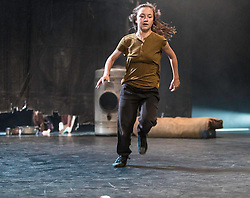Raw, performed by Belgian dance company Kabinet K at the Edinburgh International Festival places children right at the centre of their powerful, high-energy dance-theatre work. Choreographed by Joke Laureyns and Kwint Manshoven with live music by Thomas Devos seven children aged between 8 and 12 inhabit a rubble-strewn landscape of tins, rocks and a dirty mattress.