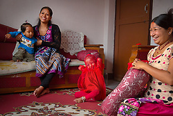 Resuka Maharjan, 2, plays after day care while waiting for worshipers to visit. Several female family members also served as kumari.
