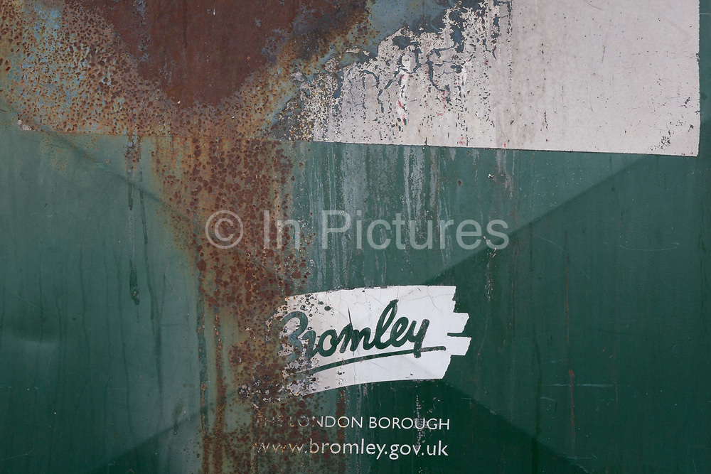 A detail of a rusting recycling bin showing the logo for Bromley Borough Council, on 3rd February 2020, in St. Mary Cray, London, England. Bromleys population in the 2011 census was 309,392. All major religions are represented, but of those stating a choice, 60.07% described themselves as Christian. Its 2019/20 Portfolio Budget Education, Health, Environment & Community,  Recreation & Housing, Public Protection & Enforcement etc. totalled £200m.