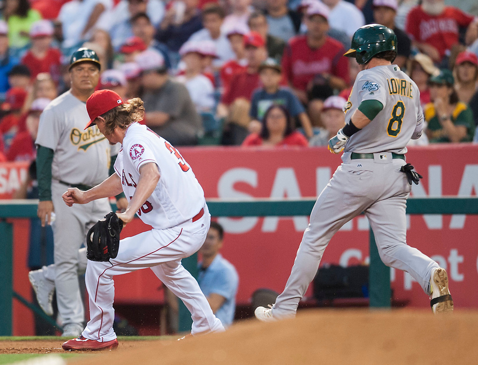 The Angels' Jered Weaver get the out at first on the Athletics' Jed Lowrie in the third inning at Angel Stadium on Friday.<br /> <br /> ///ADDITIONAL INFO:   <br /> <br /> angels.0625.kjs  ---  Photo by KEVIN SULLIVAN / Orange County Register  --  6/24/16<br /> <br /> The Los Angeles Angels take on the Oakland Athletics Friday at Angel Stadium.<br /> <br /> <br />  6/24/16