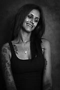 A studio portrait of a tattooed girl