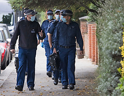 © Licensed to London News Pictures. 17/10/2021. London, UK. Members of a police search team arrive at the home of Ali Harbi Ali in Kentish Town, North London. Ali Harbi Ali, a 25-year-old Briton of Somali heritage, is currently detained over the killing of MP Sir David Amess at his Southend constituency. Photo credit: Ben Cawthra/LNP