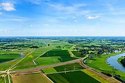 Nederland, Overijssel, Gemeente Heerde, 17-07-2017; hoogwatergeul Veessen - Wapenveld. In het kader van het Programma Ruimte voor de Rivier is de rivierdijk verlaagd en is er een inlaat gemaakt. Het inlaatwerk heeft doorstroomopening bij extreem hoogwater kan de rivier door de hoogwatergeul stromen. Deze geul bestaat uit twee paralel lopende dijken.<br /> Rural area, west of IJssel,flood gully Veessen-Wapenveld, inlet of the flood channel. The channel has not been excavated but instead two parallel dikes are constructed.<br /> <br /> luchtfoto (toeslag op standard tarieven);<br /> aerial photo (additional fee required);<br /> copyright foto/photo Siebe Swart