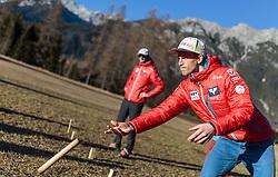 30.12.2015, Alpenhotel Karwendel, Leutsasch, AUT, FIS Weltcup Ski Sprung, Vierschanzentournee, Pressekonferenz OeSV, im Bild Michael Hayböck (AUT) beim Kubb Spiel // Michael Hayboeck of Austria plays Kubb after the Austrian Pressconference of the Four Hills Tournament of FIS Ski Jumping World Cup at the Alpenhotel Karwendel, Leutsasch, Austria on 2015/12/30. EXPA Pictures © 2015, PhotoCredit: EXPA/ JFK