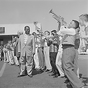 Y-570828B-11. Louis Armstrong at airport. With Phyllis Lauritz (reporter) August 28, 1957.