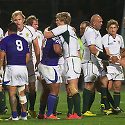 Players embrace at the end of the game after South Africa's 13-5 victory during the South Africa V Samoa, Pool D match during the IRB Rugby World Cup tournament. North Harbour Stadium, Auckland, New Zealand, 30th September 2011. Photo Tim Clayton...