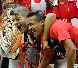 Arsenal's Santi Cazorla pours champagne over Arsenal's Jack Wilshere and Arsenal new signing, Alexis Sanchez - Photo mandatory by-line: Joe Meredith/JMP - Mobile: 07966 386802 10/08/2014 - SPORT - FOOTBALL - London - Wembley Stadium - Arsenal v Manchester City - FA Community Shield