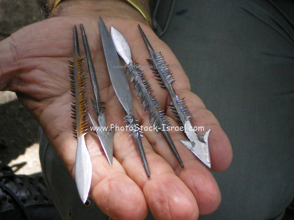 Arrowheads and Spearheads made by the Gidonwoduk tribe, the former Datooga (Datoga) blacksmith tribe. Today they are a separate tribe. They do not marry with Datoga since they discovered the secrets of blacksmithing. Photographed in Africa, Tanzania, Lake Eyasi