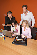 Corporate Group preparing for a presentation.