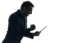 one  business man holding digital tablet happy success in silhouette on white background