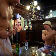 Men enjoy the Russian banya (sauna) in Moscow's famed Sandunovskaya bathhouse.
