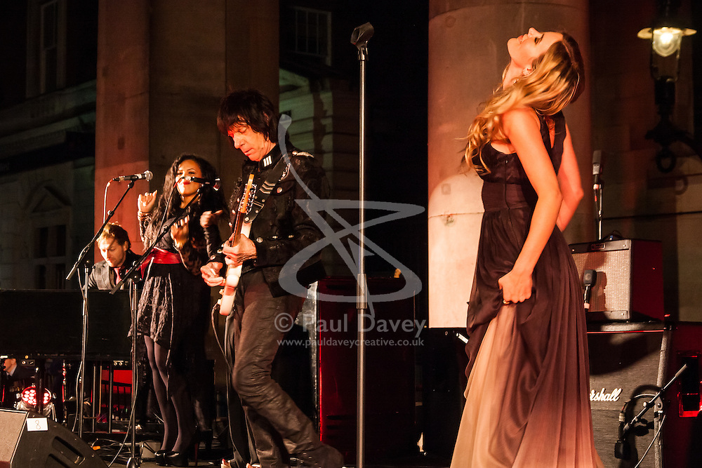 Covent Garden, London, October 30th 2014. Multi-platinum selling artist Joss Stone performs two numbers with legendary guitarist Jeff Beck as part of the events in Covent Garden where London Poppy Day events were held as the Royal British Legion raises funds, with over £1 million expected to be raised. PICTURED: Joss Stone and Jeff Beck.