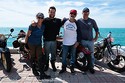 Andrea Labarbara, Loring Hill (2nd from left) and Mark Hill (R) of the Wolf Pack (4-cylinders) with Bob Zeolla and his Knucklehead on the Cross Country Chase motorcycle endurance run from Sault Sainte Marie, MI to Key West, FL. (for vintage bikes from 1930-1948). The Grand Finish in Key West's Mallory Square after the 110 mile Stage-10 ride from Miami to Key West, FL and after covering 2,368 miles of the Cross Country Chase. Sunday, September 15, 2019. Photography ©2019 Michael Lichter.