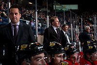 KELOWNA, CANADA - MARCH 2:  Portland Winterhawks' Associate coach Kyle Gustafson, head coach Mike Johnston and assistant coach Don Hay stand on the bench against the Kelowna Rockets on March 2, 2019 at Prospera Place in Kelowna, British Columbia, Canada.  (Photo by Marissa Baecker/Shoot the Breeze)