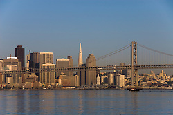 San Francisco, California: Bay Bridge and Skyline as seen from ferry in early morning. Photo 16-casanf789932. Photo copyright Lee Foster.