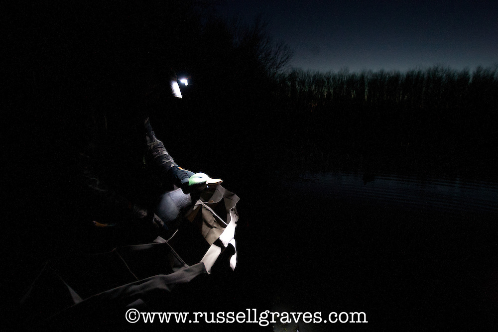 duck hunter preparing a decoy in the dark