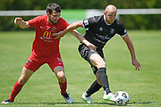 Hawke's Bay United's Bill Robertson in action under pressure from Canterbury United's Ihaia Delaney in the Handa Premiership football match, Hawke's Bay United v Canterbury United, Bluewater Stadium, Napier, Sunday, December 06, 2020. Copyright photo: Kerry Marshall / www.photosport.nz