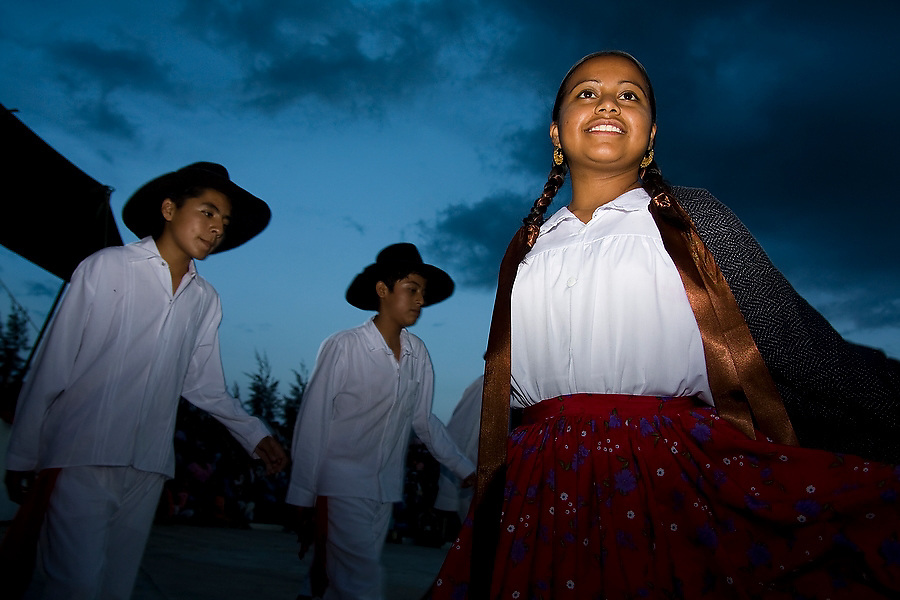 Dancers perform into the night at the Guelaguetza celebration in San Antonino Castillo Velasco, Oaxaca, Mexico on July 28, 2008. The Guelaguetza is an annual folk dance festival in Oaxaca - dancers from different regions of the state gather in celebration in Oaxaca City and towns in the Central Valley to perform their regional dances wearing traditional costumes and throw regional specialties as gifts into the crowds.
