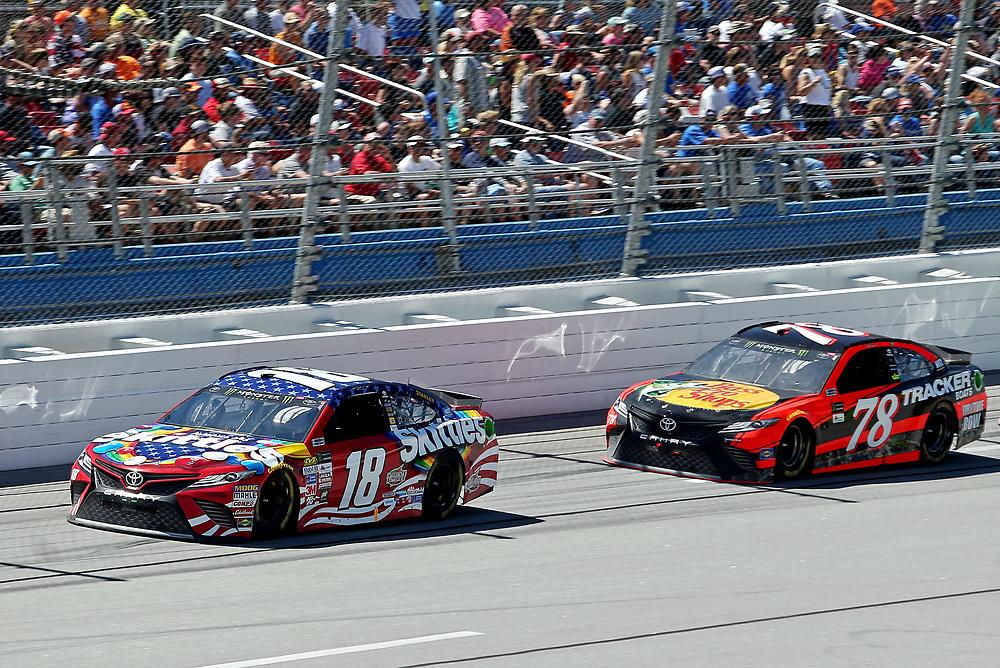 May 7, 2017; Talladega, AL, USA; NASCAR Cup Series driver Kyle Busch (18) leads NASCAR Cup Series driver Martin Truex Jr. (78) during the GEICO 500 at Talladega Superspeedway. Mandatory Credit: Peter Casey-USA TODAY Sports
